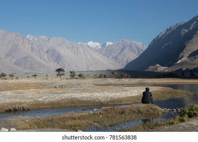 Man looking at the view of Nubra valley, Ladakh, India