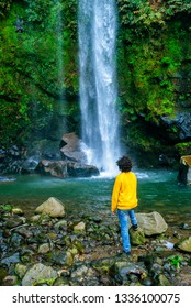 Man looking at waterfall in San Miguel, Azores Islands.