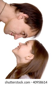 The man looks down on the girl on a white background