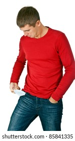 man looks with interest at his empty pocket on a white background