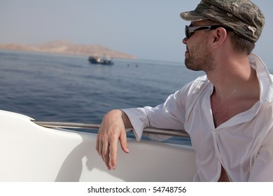 Man looks into the distance. Seascape.