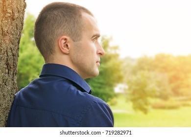 man looks into the distance, thoughtfully, background, copy space