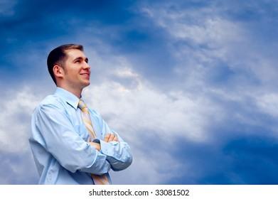 man looks on blue sky