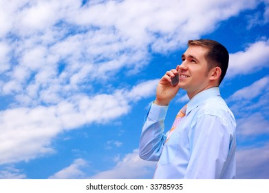 man looks on blue sky with sun and clouds