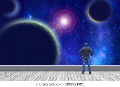Man looks at planets in the open space and dreams of space travel