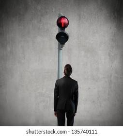 man looks red traffic light