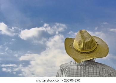 Man looks at sky.