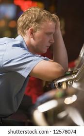 Man losing at slot machines in casino