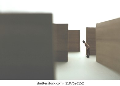 man lost in a complex abstract maze