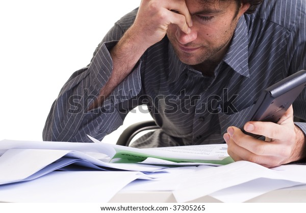 Man and  lots of paper work, looking stressed
