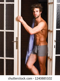Man lover near door. Sexy bachelor lover concept. That was great night. Guy attractive lover posing seductive. Sexy macho tousled hair coming out bedroom door. Seductive lover full of desire.
