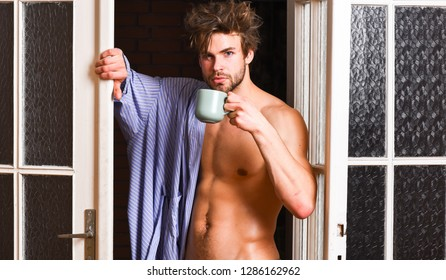 Man lover near door. Sexy bachelor lover concept. That was great night. Guy attractive lover enjoy morning coffee. Seductive lover full of desire. Sexy macho tousled hair coming out bedroom door.