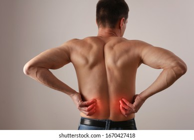 Man with low back pain. Chiropractic, Physiotherapy concept