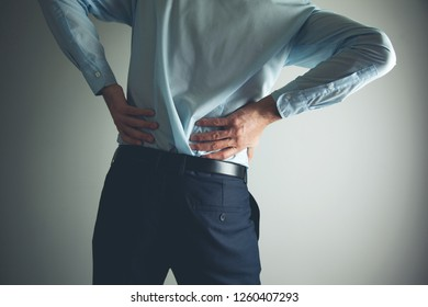 man lower back pain or waist pain