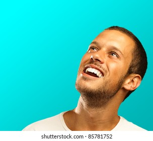 man lucky face on a blue background