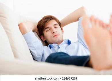 Man lying down on sofa sleep closed eyes