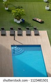 man lying in hammock in a pool