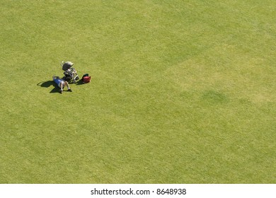 Man lying next to baby carriage on big lawn