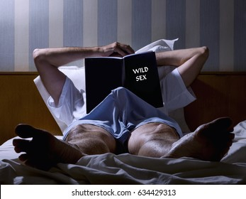 Man lying on the bed, with an erection for reading an erotic book.