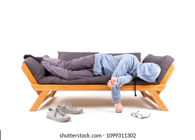 Man lying on couch with hangover isolated on white background.