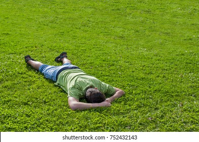 Man lying on grass and sleeping. Relaxing man lying on grass in summer