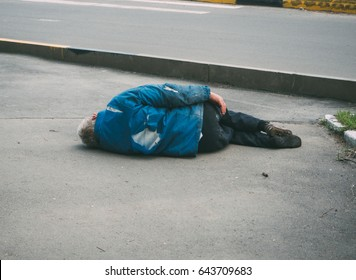 the man lying on the pavement . murder