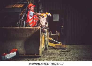Imágenes, fotos de stock y vectores sobre Man Bulldozer