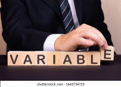 Man made word Variable with wood blocks