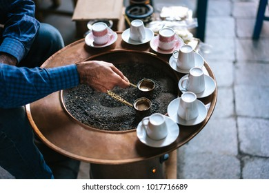 A man make Turkish coffee, close view