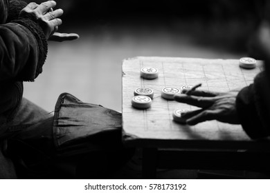 A man makes a move on Chinese Chess in Beijing, Black and White