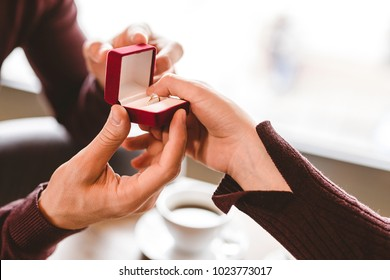 The man makes a proposal to his girlfriend