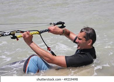 Man makes water start. Kite-surfing.