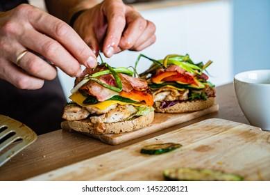 man making burger on the kitchen