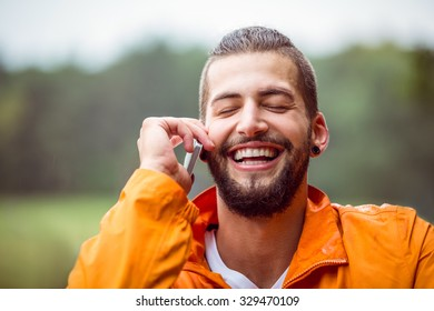 Man making a call on hike in the countryside
