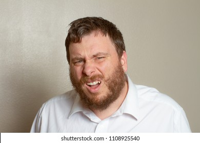 Man making a confused look at his face during a conversation