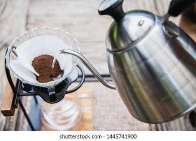 Man making drip fresh coffee in vintage coffee shop with green nature background - people with fresh coffee in nature concept