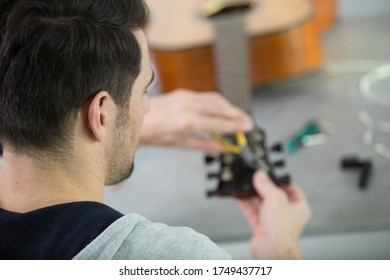 a man is making a guitar