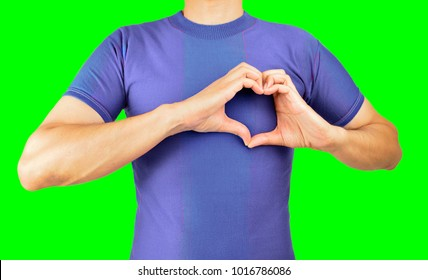 man making the heart shape with his hands in concept of love for football and his soccer team. Isolated cutout on green background with chroma key