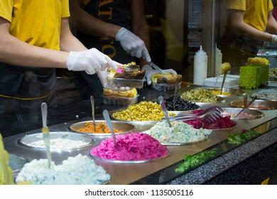 A Man making kumpir at shop