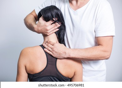 Man making a neck massage in rehabilitation center.