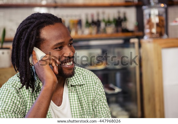 Man making a phone call in the cafe