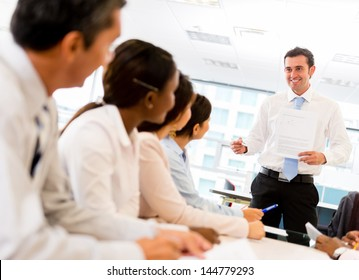 Man making a presentation in a successful business meeting