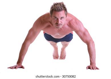 Man making push-ups and looking seriously