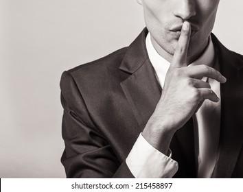 Man making silence gesture. Shh!!!