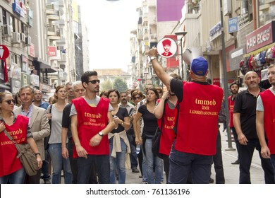 A man is making a speech with megaphone and he is walking with a crowd who protests Ankara Peace Rally Bomb explosion event in Alsancak, Izmir,Turkey- October 13, 2015