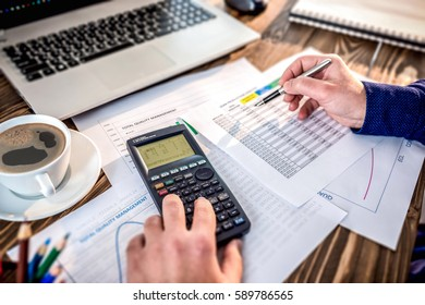 Man Making Statistical Analysis On Lean Production Report