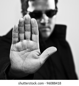Man making stop gesture