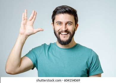 Man making Vulcan salute isolated on gray