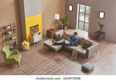man or manager is working from home. Freelancer human study or work from home modern home office and decorative living room style. Brown wall background with fireplace.