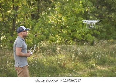 Man manages quadrocopters. Remote control for the drone in the hands of men. Unmanned aerial vehicle